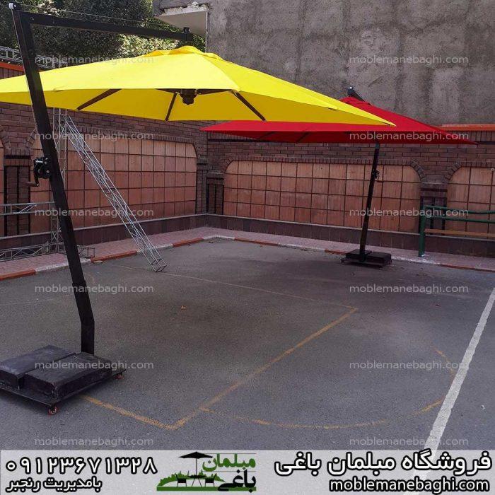 چترباغی مدل پایه کنار در رنگ قرمز و زرد در حیاط مدرسه شاد گوهردشت کرج