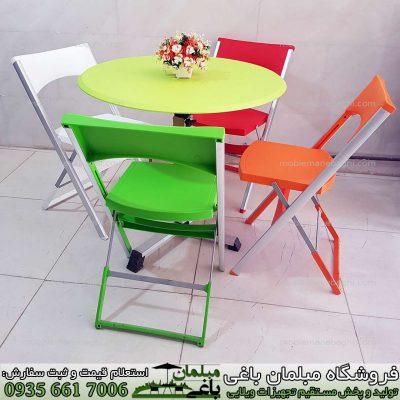 میز و صندلی تاشو مسافرتی ست چهار نفره همراه با میز تاشو گرد مخصوص فضای باز و مسافرت و مکانهای کم جا مانند کنار استخر و آلاچیق دورهمی