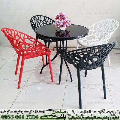 صندلی پلی کربناتی مدل درختی ست چهار نفره درجه یک در رنگ های مشکی قرمز و سفید با تنوع رنگ بالا صندلی پلی کربناتی باکیفیت مدل درختی بسیار شیک مخصوص فضای باز و مکان های شیک
