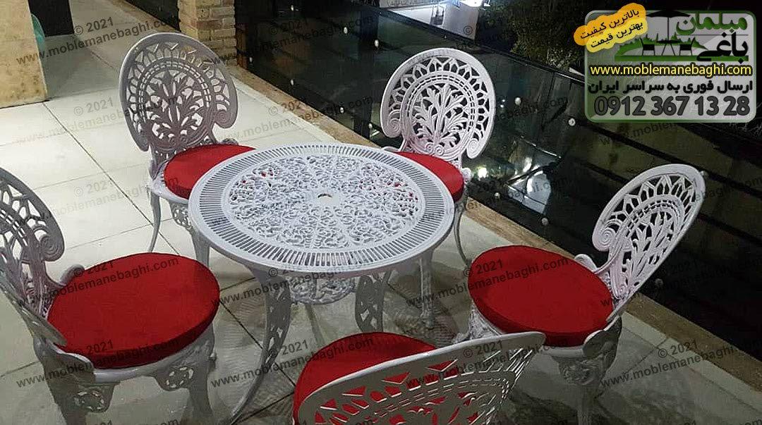 ست میز و صندلی آلومینیومی مدل طاووسی با تشک قرمز در تراس ویلایی زیبا در شیراز استان فارس ارسالی مشتری فروشگاه مبلمان باغی